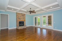 Circle H Builders Columbi SC living room with fireplace and coffered ceilings.